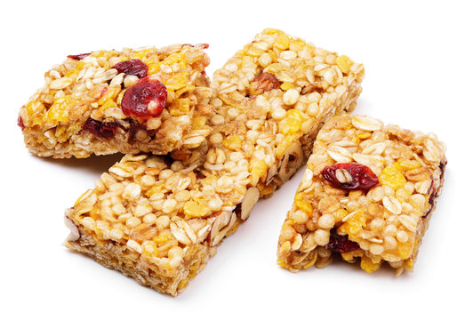 Broken healthy granola bar (muesli or cereal bar) isolated on white background