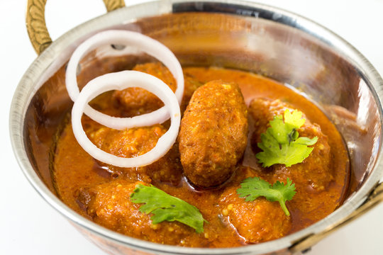 Malai Kofta or meatballs - Traditional Indian food  served in a brass utensil