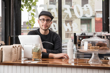 Male employee in cafe, New York, USA