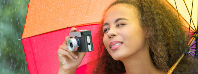 Afroamerican girl taking a photo