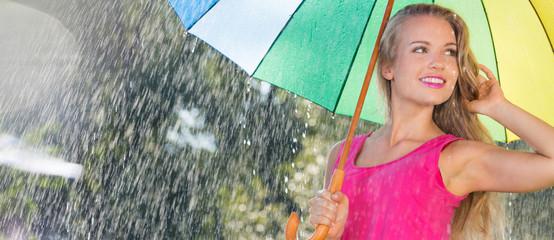 Blonde girl under colorful umbrella