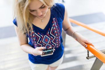 Teenage girl outdoors, using smartphone