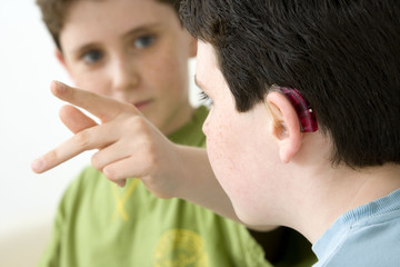 Models Do not use for HIV A young boy and his brother using the French sign language to discuss with his hearing-impaired brother The French sign language uses signs to designate words but also dactylology (each letter of the alphabet is represented by a defined position of the fingers then enabling to spell a word) and the lip reading The young boy designates the letter \k\ (see image nᄚ0833202 and series of images from nᄚ0572308 to 0573508 to see the other letters of the alphabet)