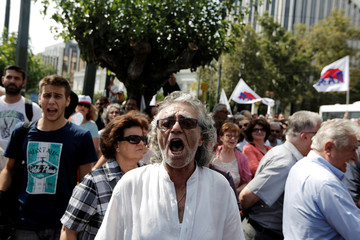 Members of the communist-affiliated PAME trade union shout slogans during a anti-austerity rally in front of the parliament in Athens