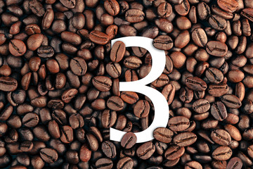 number three on coffee bean background concept