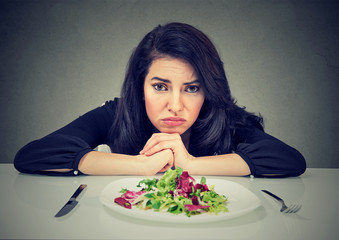 Dieting habits changes. Woman hates vegetarian diet