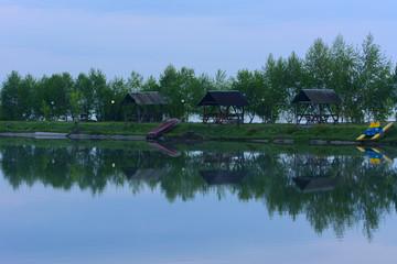 Beautiful sunlight shining on a lake with a mirror, like reflections.