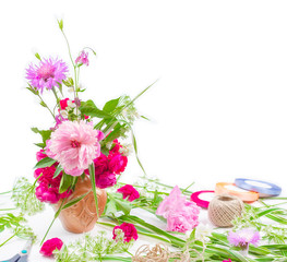 floral design. beautiful bouquet of pink flowers peons, cornflowers and red roses on white background with space for text