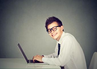 Technology geek man working on his laptop