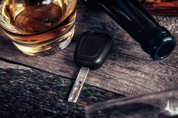 Car key and whisky on bar table