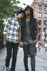 Young black gay couple walking in the street