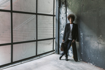 Casual afro businessman on a industrial space