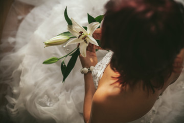 Bride Holding White Lily