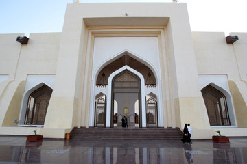 People walk at Imam Muhammad ibn Abd al-Wahhab Mosque in Doha