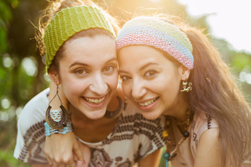Friendship - two girls having fun in front of camera
