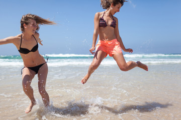 Best Friends Having Fun on the Beach  Summer Holiday