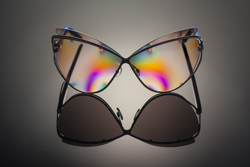 Front view of transparent polarized colorful reflected sunglasses