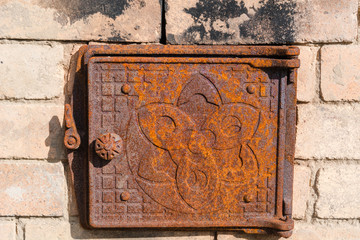Furnace door. Rusty door of the furnace.