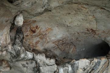 Phang Nga Bay, Thailand - May 12th 2017: Prehistoric cave paintings on limestone walls