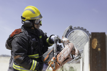 Firefighter practicing with a disc cutter