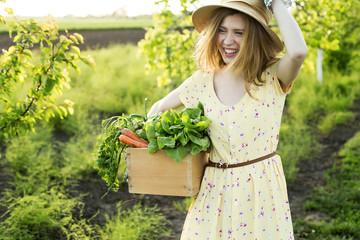 Smiling girl in a garden