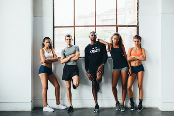 Portrait of multiethnic group of athletes standing in the gym