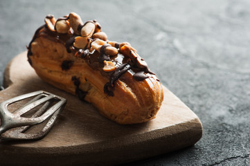 Eclairs with peanuts, chocolate icing