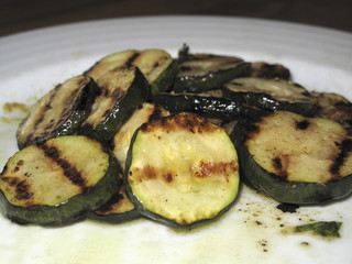 Grilled zucchini on white plate