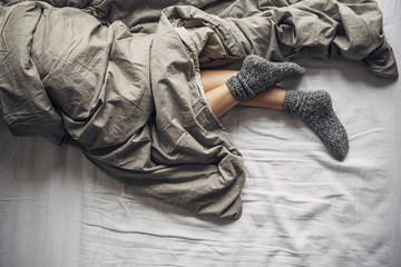 Woman Wearing Woollen Socks Sleeping in Bed