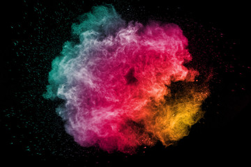 color powder explosion on black background. Mauve color cloud. color dust explode. Freeze motion paint Holi.