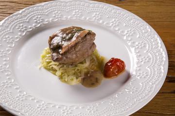 Saltimbocca veals in rich Neapolitan sauce and tagliatelle pasta