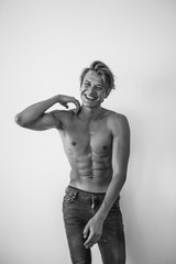 Black and white portrait of a young blonde man shirtless
