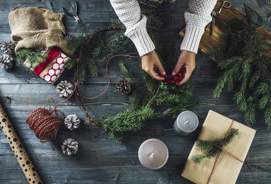 Woman Makes a Christmas Wreath