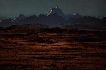 An interstellar landscape with a starry sky