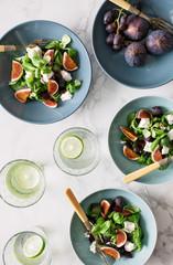 Healthy salad Fig and goats cheese salad bowls