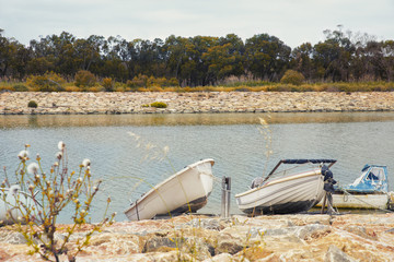 modest fishing boats in the river bank.