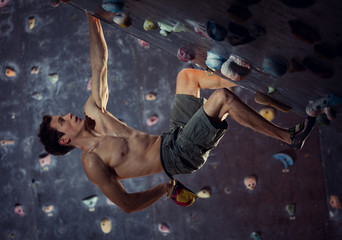 Man Free Climbing Indoors