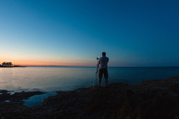 Photographer taking a photo of a sea view