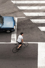 Urban cyclist vs car on crosswalkLook from above
