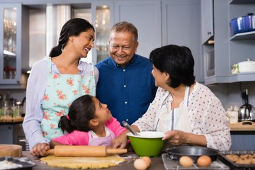 Portrait of family standing together in kitchen