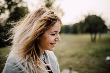 Portrait of a young beautiful woman smiling outdoors