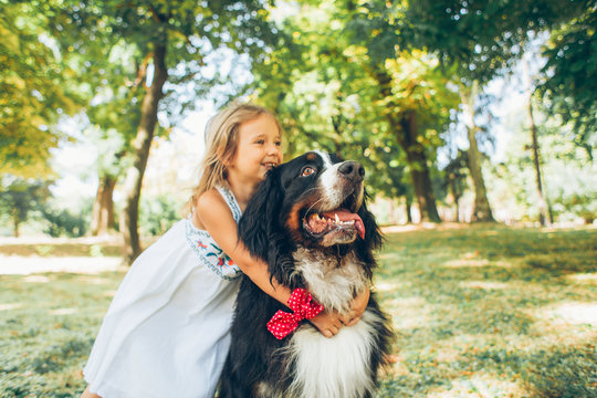 Small Blonde Girl With Huge Dog