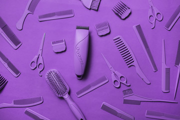 Various hairdresser tools in purple color on purple background