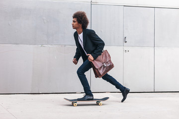Modern afro businessman go to work on a skateboard Ecological concept