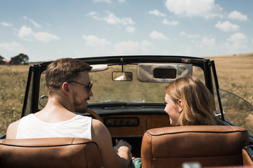Couple in Love Driving in Convertible Car