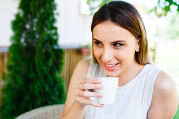 Beautiful girl smiling and drinking coffe