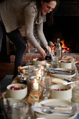 Woman setting the table for dinner party
