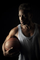 Young black man with basketball