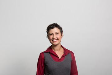 studio portrait of an excited businesswoman