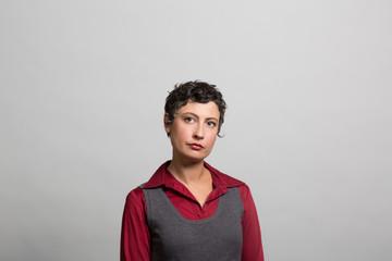 studio portrait of a pensive businesswoman